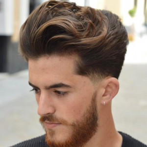 Long Brushed Back Hair Low Fade